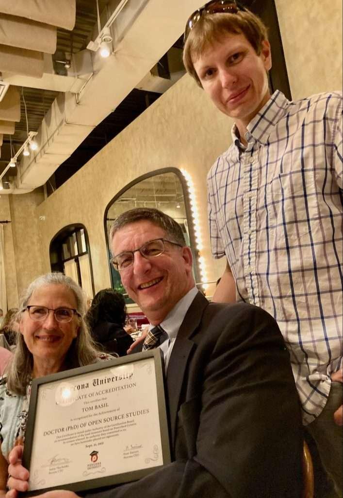 Peter awards Tom a Percona University PhD!