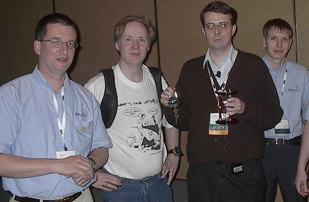 Tom, Monty Widenius (MySQL Founder), Heikki Turri (InnoDB Creator), & Peter, at the 2nd ever MySQL User Conference, 2004